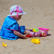 Two-year-old girl playing in a sandbox — Stock Photo
