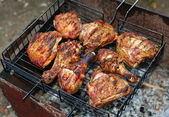 Chicken legs on the grill for barbecue — Stock Photo