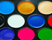 Watercolor paints in a box close up as background — Stock Photo