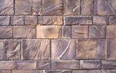 The texture of the wall of the great gray-brown polished stones — 图库照片