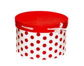 Large round white gift box with red dots on a white background — Stock fotografie