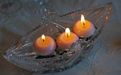 Crystal capacitance with three burning candles — Stock Photo