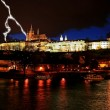 the prague castle at night along the river vltava — Stock Photo