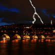 Charles Bridge at night along River Vltava — Stockfoto #29369059