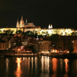 Night view of beautiful Prague City along River Vltava — Stock Photo #29378477
