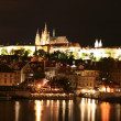 The magnificent Prague Castle at night along the River Vltava — Stock Photo