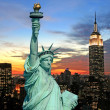 The Statue of Liberty and New York City skyline — Stock Photo #29390827