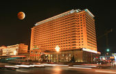 The famous Beijing Grand Hotel and Moon Eclipse — Stock Photo