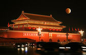 Tian-An-Men Square and moon eclipse — Stock Photo