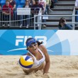 Mayra Garcia (MEX) dives for the ball during the FIVB International Beach Volleyball tournament — Stock Photo