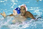 Wpo: świata w pływaniu - półfinał - mistrzostwa usa vs hiszpania. jeffrey uprawnień, ivan perez. — Zdjęcie stockowe