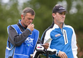 Matthew Zions (AUS) and caddy in action on the third day of the European Tour, 14th Open de Saint-Omer. — Stock Photo