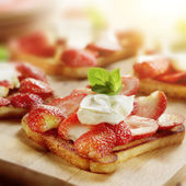 Toast with strawberries mascarpone and lemon and a garnish — Stock Photo