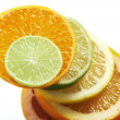 Citrus fruits slices stacked together — Stock Photo
