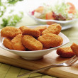 Chicken nuggets in a white bowl — Stock Photo #29358211