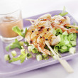 Grilled prawns on a skewer served on a plate with a salad — Stock Photo #29364423