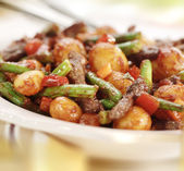 Meat strips with beans pepper potato and tomato sauce — Stock Photo