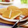 Stock Photo: Wiener schnitzel served on white plate