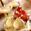 Stewed pear served with ice cream — Stock Photo