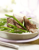 White rice with green beans and steak — Stock Photo