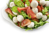 Healthy fresh rucola salad with mozarella and tomato slices — Stock Photo