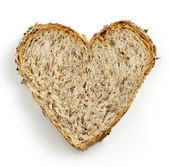 Heart shaped slice of brown bread — Stock Photo