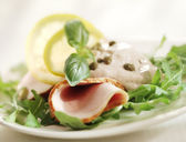 Rucola salad with ham and sauce — Stock Photo