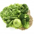 Lots of diffrent green foods arranged together isolated on a whi — Stock Photo #36322827