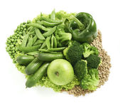 Lots of diffrent green foods arranged together isolated on a whi — Stock Photo