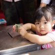 Stock Photo: BANGKOK, THAILAND - October 3 : Thai Buddhist baby girl donates