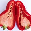 Red pepper cut into 2 parts — Stock Photo #30964089