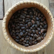 Stock Photo: Pine nuts in a barrel
