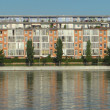Multi-storey building on the banks of the river — Stock Photo