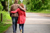 Walking young woman and man — Stock Photo
