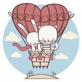 猫とウサギのハートの形で大きなバルーンで飛んでいます。 — ストック写真
