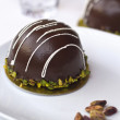 Chocolate dessert with pistachio — Stock Photo #29234783
