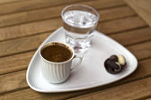 Cup of coffee with a glass of water — Stock Photo