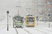 Winter city with trams and snow — Stock Photo
