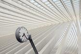 Futuristic railway station clock — Stock Photo