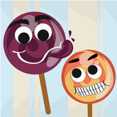Two candies with faces — Stock Vector