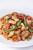 Flat rice noodle stir fried withseafood. — Stock Photo