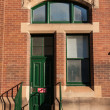 Red Brick Wall with a green Door and Window — Stock Photo #30040447