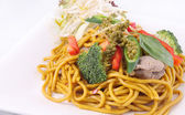 Hokkien noodles stir frief with Thai herb. — Stock Photo