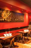 Interior of modern restaurant , empty glass on table. — Stock Photo