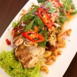 Thai deep fried fish with herb salad — Photo