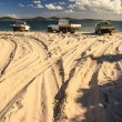 Trucks on beach dunes — Stock Photo