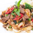 Stir fried flat rice noodles with basil sauce. — Stock Photo