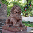 Guard lion in Datsan Gunzechoyney in Saint-Petersburg — Stock Photo #48680811