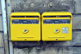 Two yellow mailboxes — Stock Photo