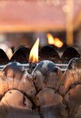 Flame in the metal lotus for worship buddha — Stock Photo